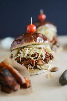 BBQ Jackfruit Pretzel Sandwiches with sauerkraut, sautéed onions & mushrooms, of course. Drooling!