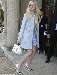 So stylish: Elle Fanning looked pretty as a picture in her pale blue coat and checked top and mini-skirt. Love the color and design of this coat.