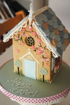 Bath Baby Cakes - Consider a centrepiece like this iced biscuit house for your spring and summer party.