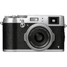 """Fujifilm X100S  / I like to use this camera for street photography as well as concerts that won't let me take my """"Pro"""" camera. Little do they know that this guy has a 24mm lens with a fixed f/2. It also has a nice throwback look / feel. http://www.bhphotovideo.com/c/product/1080889-REG/fujifilm_16440616_x100t_digital_camera_silver.html"""