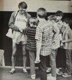 Freshman Steve Prefontaine,  age 19,  June 5 1970, Oregon Twilight Meet, Hayward Field, Eugene OR, signs autographs after placing 2nd in mile with 3:57.4 time, his first sub-four minute mile. <3