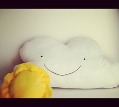 double sided pillow, one side happy one side sad. comes with a sun and rain drops. Its a great interactive unique gift for kids