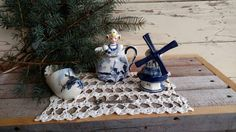 Check out this item in my Etsy shop https://www.etsy.com/listing/501697357/vintage-white-delft-blue-collectible-set