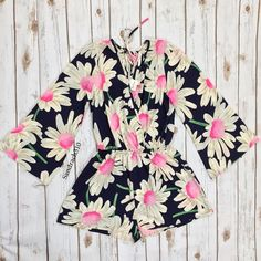 Floral print bell sleeve romper Brand: Black Bead  Size: M New  Floral bell sleeve romper  Deep V neckline  Tie back detail  Bell sleeves  Elastic waist band  Colors: Navy, Pink, and White  95% Rayon 5% Spandex No Trade Black Bead Pants Jumpsuits & Rompers