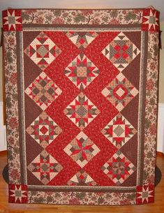 "Looking at settings for a sampler quilt I'm working on. Love the contrast of the bold red background v. the neutral brown.    ""Cherry Fizz"" Sampler Quilt by dawnasfolkart, via Flickr"