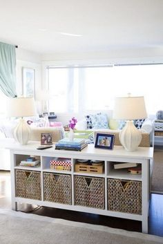 A Behind The Couch Furniture Piece is Great for Storing Things out of The Way in Your Living Room.