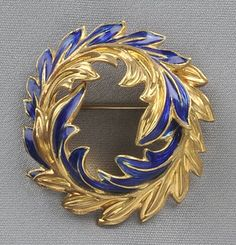 18kt gold leaf motif with blue enamel accents, signed Tiffany & Co., Italy