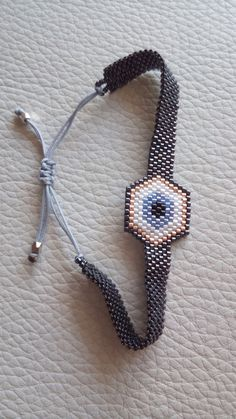Evil Eye beaded bracelet with adjustable closure, Talisman seed bead charm, Made in Gree. Progress video of a loom bracelet 💕 Miyuki evil eye charm bracelet set for women unique and chic Cute Bracelets, Seed Bead Bracelets, Seed Beads, Bead Jewelry, Talisman, Evil Eye Bracelet, Bracelet Set, Organza Gift Bags, Boyfriend Gifts