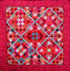 """First red quilt: """"Square Clamshell"""" by Nifty Quilts, from a class by Kaffe Fassett"""