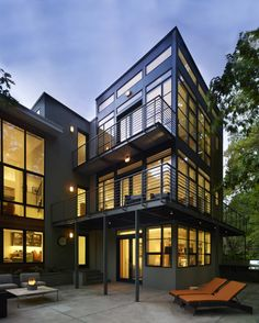 Patio and two catwalks/balconies. Lakefront Residence, by Moore Architects. Falls Church, Virginia. #patio #balcony #exterior