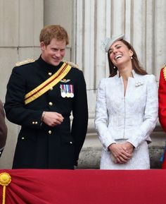 Prince Harry and Catherine, Duchess of Cambridge share a joke on the balcony during Trooping the Colour - Queen Elizabeth II's Birthday Parade, at The Royal Horseguards on June 14, 2014 in London, England.