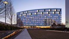 A curved glass facade gives this women's hospital a generous and expansive appearance, and its syncopation of vertical elements reflect the diverse functions housed within. The facility consolidates women's services, improving efficiency and providing