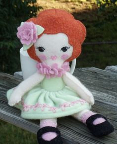 Doll made from felted sweaters, cashmere and wool. Ginger melon pattern.