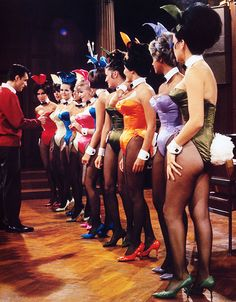 Hugh Hefner inspecting the new improved fabric for the Playboy Bunny costumes, Chicago 1966