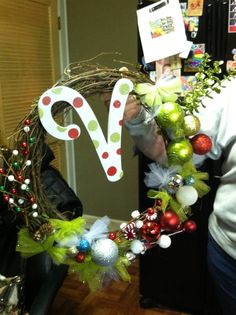 Wreath. Made with picks, bulbs, tulle, little ornaments. Lots of hot glue and wire