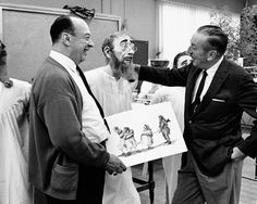 Imagineer Marc Davis and Walt Disney discuss the scene with the dunking of the mayor at the town well Photo courtesy of Disneyland