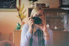A girl focused on a camera by Kasia Górska on @creativemarket