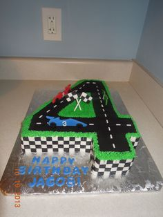 race track cake - fondant road, checkers, and little cars.