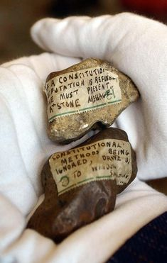 Stones thrown by Suffragettes through a Buckingham Palace window 100 years ago.
