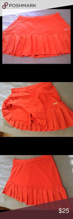 "Fila workout skorts Cute orange skort with pleating detail . Built in shorts . No pockets .  Waist 28"" . Length 13"". fila Shorts Skorts"