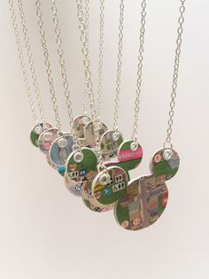Charms Jewelry Disney Finds - Upcycled Disney Park Map Necklaces - I love when people are able to recycle things we would normally throw away and make something new and exciting. Etsy designer TheCreativeBee is able to do just that with Disney Park Maps. Disney Parks, Disney Park Maps, Disney Map, Disney Cruise, Disney World, Walt Disney, Map Necklace, Initial Necklace, Jewelry Necklaces
