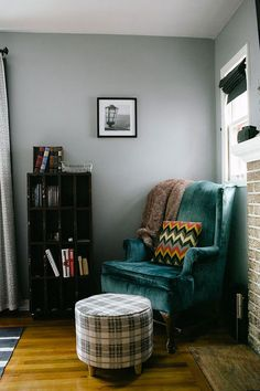 "Sneak Peek: Kristin & Michael Dekay. ""I have two of these teal Ethan Allen wing chairs, purchased on Craigslist. The pillow was sewn by yours truly, as well as the roman shades on the little window. The ottoman is from Target's holiday collection. I think I will keep it here year-round."" #sneakpeek"
