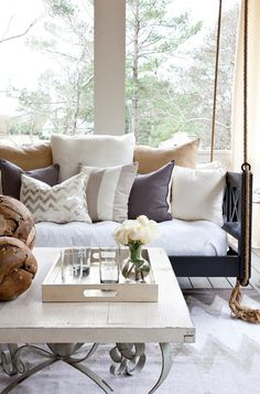 my dream porch always includes a porch swing with too many pillows, a ceiling fan, rocking chairs, and plants I'll eventually kill. wine and books a must.