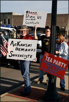 """(check it out, the guy in the back is having that old """"your/you're"""" problem.  no surprise.) as for the dude with the hat, seriously, i really don't know what he is trying to say.  I assume he's tried to spell """"sovereignty"""" - what does that mean?  does he want a king? or does Arkansas want to be a sovereign nation? or what exactly? anybody out there who speaks Tea that can explain this to me?"""