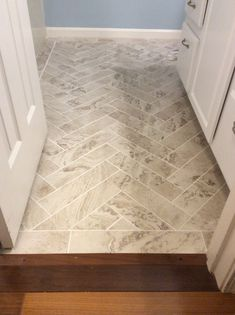 "Peel and stick Light Travertine 18"" x 18"" from Home Depot"