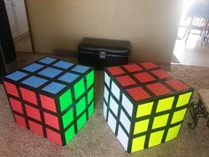 Decorated end tables as Rubiks Cube for 80s party. Poster boards and black duck tape!