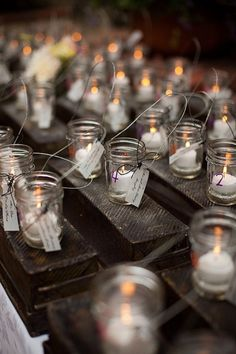 jar candle Place settings/favors... i believe the tags have the peoples names & the jars have the table numbers... love how simple it is!