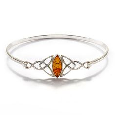 Celtic Knot Bangle Bracelet with Baltic Amber in the middle - you'll love this stunning amber bracelet! Shipped in 24 hours and delivered with a Free Gift Box!