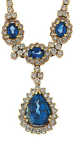 A sapphire and diamond necklace The front set with three circular-cut sapphire and brilliant-cut diamond clusters, interspersed with similarly cut diamond quatrefoils, suspending a pear-shaped sapphire within a brilliant-cut diamond surround, to a brilliant-cut diamond line necklace, 43.5cm long