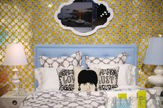 jonathan adler bedroom.. adler and i have such a strange relationship.. those pillows are fab and the mirror is a gem~