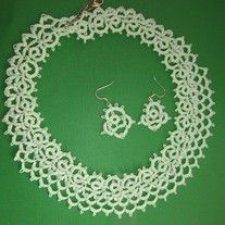 This elegant choker necklace with its white baby pearl glass beads makes a delicate accent for any outfit.  It is needle tatted from #10 cotton thread. It is approximately 18 inches around and tapers from 1 inch at the back of the neck to 1 1/4 inches at the front. It fastens with a silver lobs...