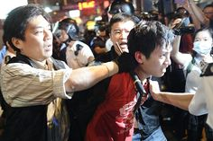 Umbrella Revolution Hong Kong, A Pro-democracy protester is being arrested by riot police forces, after clashing with police at Sai Yeung Choi Street at Mongkok district on November 29, 2014 in Hong Kong, Hong Kong. Again protesters and supporters gathered in the Mongkok district to protest against clearing the Mong Kok pro-democracy protest site on November 26, dispersing protesters and reopening roads and intersections, which were blocked for almost two months.