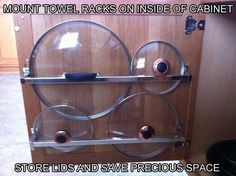 Pick up a few towel racks at your local hardware store to do this: