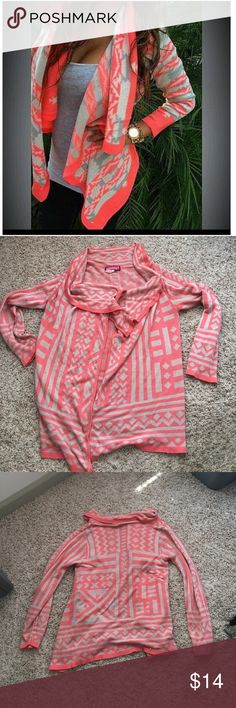 💕Coral Aztec/Tribal Flowy Cardigan💕 This cardigan is nice and lightweight . It's perfect for spring. It's a coral and taupe color. It's gently worn, maybe wore it like 5 times. It's super nice it just doesn't fit me anymore. Feel free to ask any questions. No trades. Offers welcomed. *lifestyle image added for inspiration Say What? Sweaters Cardigans