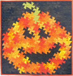 Twister Jack quilt at The Quilt Works. Pattern by Need'l Love