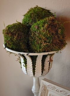 DIY moss balls, sheets of preserved sheet moss (Hobby Lobby), wrapped around Styrofoam ball and secured with straight pins (the needles with the tack at the end)