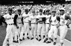 Baseball's top Latin American players — Felix Mantilla, Roberto Clemente, Tony Oliva, Cookie Rojas, Juan Marichal, Zoilo Versalles, Vic Davalillo and Leo Cardenas — pose before on the field before the 1965 All-Star game. (Herb Scharfman/SI)