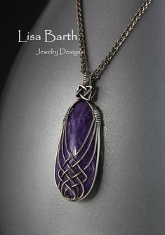 Here is a criss cross variation in sterling wire over a beautiful Charoite cab from Russia. __Lisa Barth