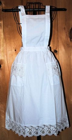 Apron measures 38 inches in length and 27 inches from the waist to the hem. 50% Cotton 50% Poly. Machine Washable.
