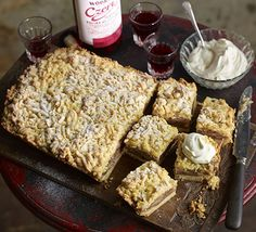 Polish apple cake (Szarlotka). This traditional spiced cake is served with a cinnamon whipped cream and a dusting of icing sugar