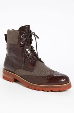 $465, Dark Brown Leather Brogue Boots: Bruno Magli Paciano Wingtip Boot. Sold by Nordstrom. Click for more info: https://lookastic.com/men/shop_items/24588/redirect