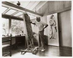 Dr. Seuss working in his art studio.