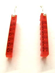 Earrings made from a broken tail light.