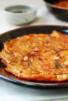 These super easy kimchi pancakes are crispy on the outside and chewy and flavor-packed on the inside thanks to spicy fermented kimchi, scallions and squid. Serve these savory Korean pancakes with my sweet and sour dipping sauce. Korean Dishes, Korean Food, Savoury Pancake Recipe, Pancake Recipes, Waffle Recipes, Breakfast Recipes, Korean Pancake, Korean Kimchi Pancake Recipe, Kimchi Recipe