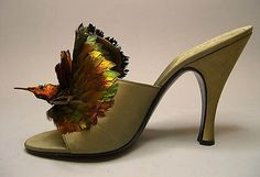 Evening shoes House of Dior (French, founded 1947) Designer: Roger Vivier (French, 1913–1998) Manufacturer: Delman (American, founded 1919) Date: 1954 Culture: French Medium: silk, feather Dimensions: Length: 7 3/8 in. (18.7 cm) Height (of heel): 3 3/4 in. (9.5 cm)