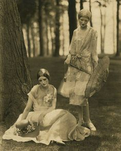 Edward Steichen, Model Marion Morehouse in a bouffant dress and actress Helen Lyons in a long sleeve dress by Kargère; masks by the illustrator W.T. Benda, 1926.